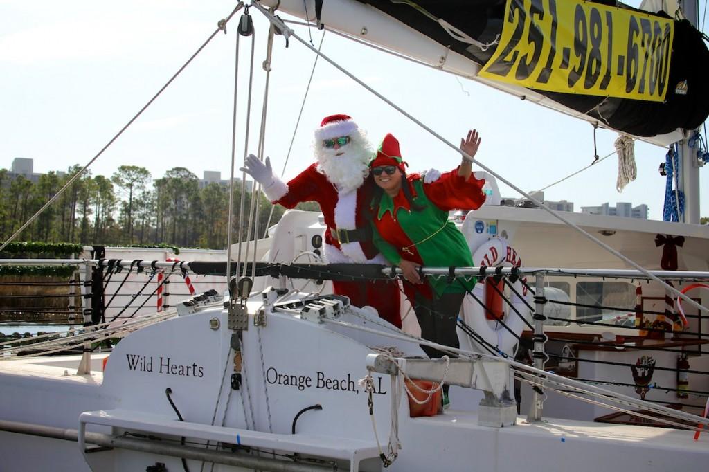 Wild Hearts Christmas boat parade Santa and Helper